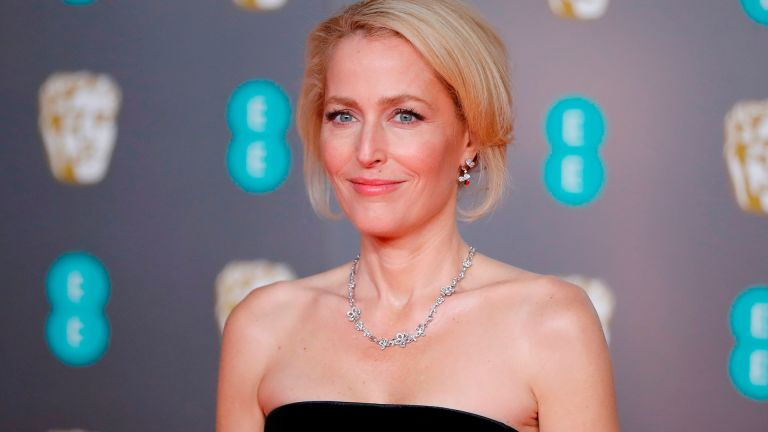 US actress Gillian Anderson poses on the red carpet upon arrival at the BAFTA British Academy Film Awards at the Royal Albert Hall in London on February 2, 2020. (Photo by Tolga AKMEN / AFP) (Photo by TOLGA AKMEN/AFP via Getty Images)