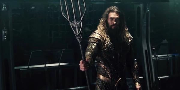 Jason Momoa as Aquaman holding trident