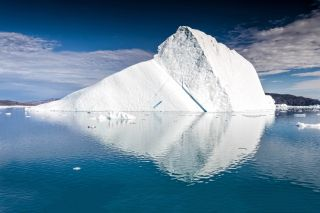 A massive iceberg floating on its side in Greenland