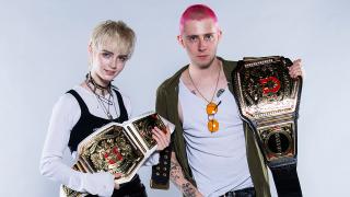 Wargasm holding wrestling belts