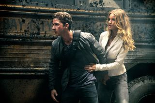 Shia LaBeouf and Rosie Huntington-Whiteley try to save the day