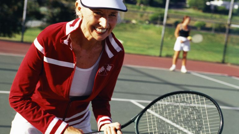 Older woman playing tennis