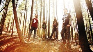 A press shot of Spirit Adrift stood in a sunny forest