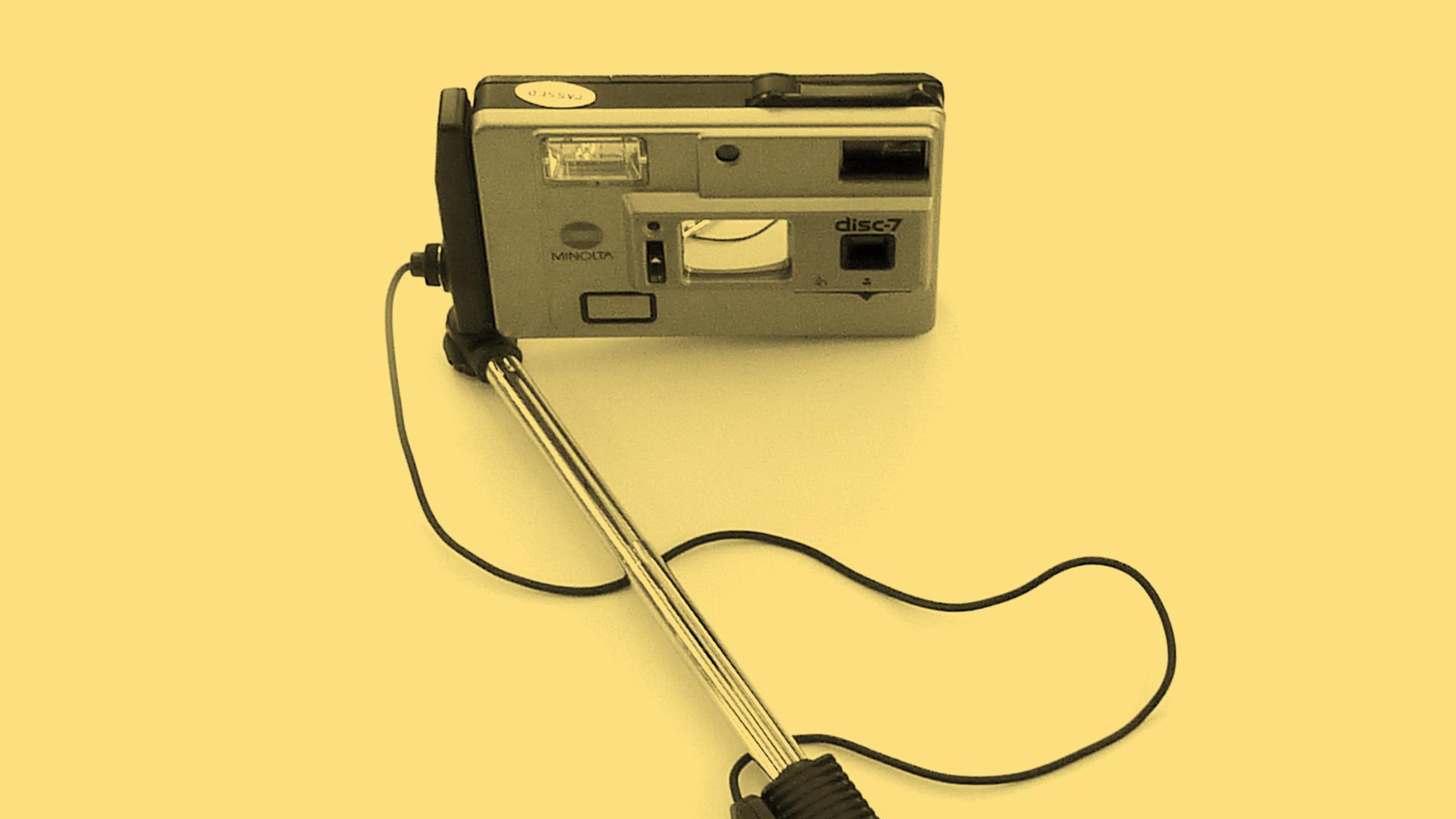 The Minolta 7 Disc camera mounted on its selfie stick