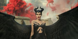 Maleficent: Mistress of Evil Angelina Jolie stands among red explosions