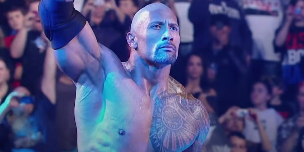 The Rock standing stoic in WWE ring
