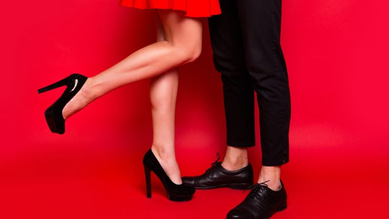How to seduce a man: couple legs red background