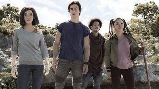 Rosa Salazar, Keean Johnson, Jorge Lendeborg Jr., and Lana Condor search the woods together in Alita: Battle Angel.