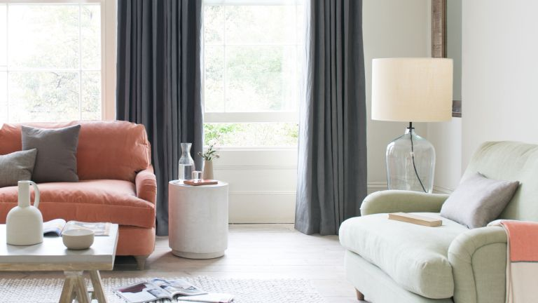 grey curtains in living room with white scheme and blush sofa by loaf