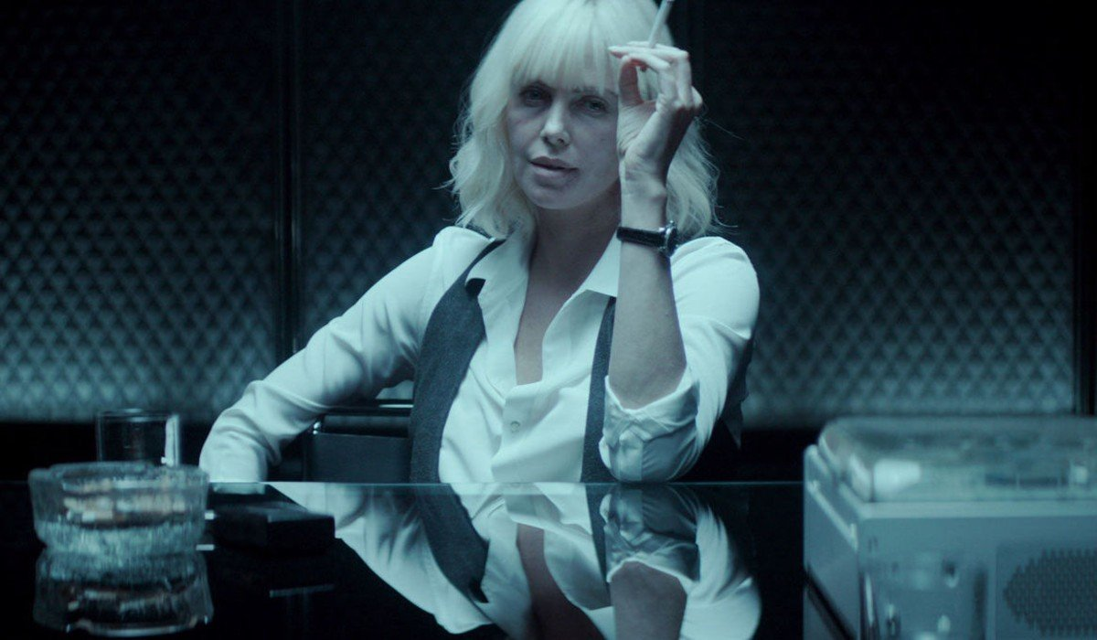Atomic Blonde Charlize Theron smoking during an interrogation