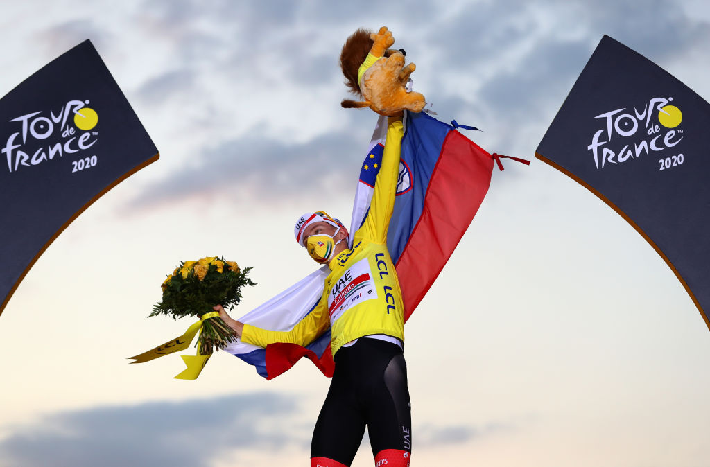 PARIS FRANCE SEPTEMBER 20 Podium Tadej Pogacar of Slovenia and UAE Team Emirates Yellow Leader Jersey Celebration Mascot Flowers Mask Covid safety measures Slovenian Flag during the 107th Tour de France 2020 Stage 21 a 122km stage from MantesLaJolie to Paris Champslyses TDF2020 LeTour on September 20 2020 in Paris France Photo by Michael SteeleGetty Images