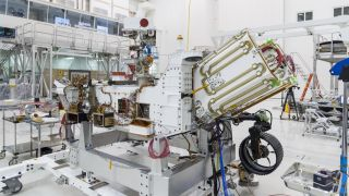 The Mars 2020 rover's propulsion system, a so-called Multi-Mission Radioisotope Thermoelectric Generator (MMRTG), is deployed at the far end of the rover, between the white fields of gold tubes.