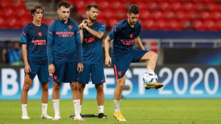Sevilla players warm up in a training session for the 2020 UEFA Super Cup match against Bayern Munich.