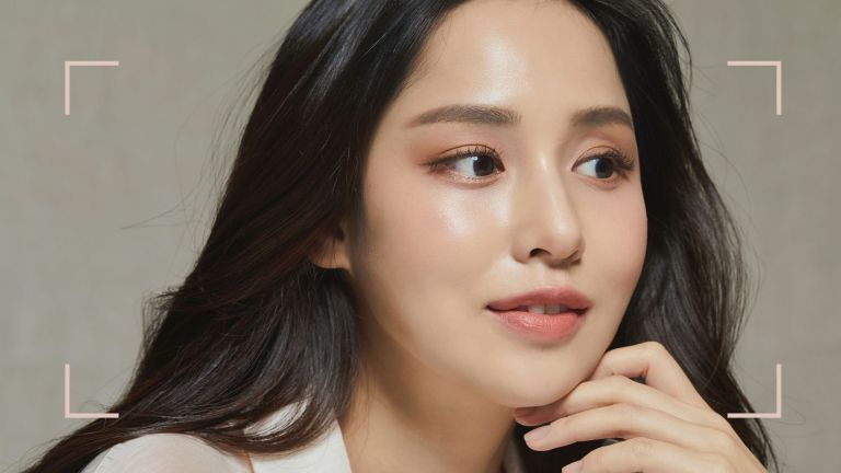main closeup of woman with dewy glass skin