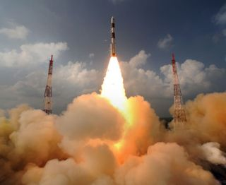 India's first mission to Mars, the Mars Orbiter Mission, launches the Mangalyaan orbiter toward the Red Planet atop a Polar Satellite Launch Vehicle on Nov. 5, 2013 from the Indian Space Research Organisation's Satish Dhawan Space Centre in Sriharikota.