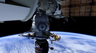 This still from a NASA animation shows how Russian cosmonauts Oleg Kononenko and Anton Shkaplerov will use one crane to move another outside the International Space Station during a Feb. 16, 2012 spacewalk.