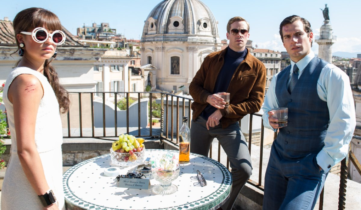 The Man From U.N.C.L.E. Alicia Vikander, Armie Hammer, and Henry Cavill having a rooftop drink