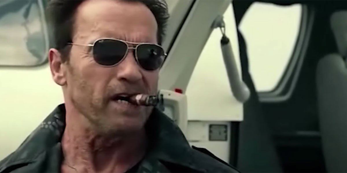 Arnold Schwarzenegger smoking a cigar.
