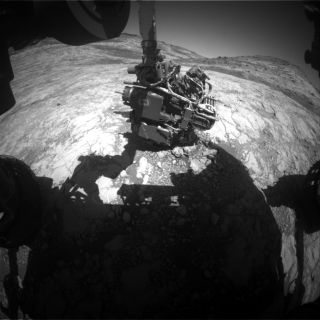 This image by one of the Curiosity Mars rover's hazard cameras shows the robot's arm extended out to perform an analysis of the bedrock. Curiosity has to know the exact angle of every joint to move safely.