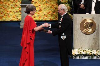 Donna Strickland receives her Nobel Prize from King Carl XVI Gustaf of Sweden during the award ceremony on Dec. 10, 2018 at the Concert Hall in Stockholm, Sweden.