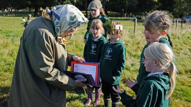 The Queen meets children from Crathie Primary School in Scotland