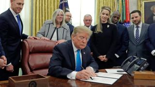 President Donald Trump signs Space Policy Directive-4 in the Oval Office of the White House on Feb. 19, 2019. SPD-4 directs the Pentagon to establish a Space Force.