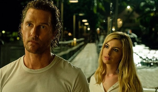 Serenity Matthew McConaughey and Anne Hathaway have a night time conversation on a dock