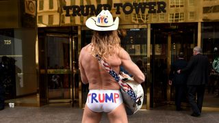 American icon The Naked Cowboy outside Trump Tower