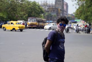 man in heat wave in kolkata