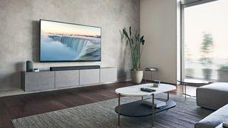 the sony ht-a7000 soundbar below a TV in a stylish living room