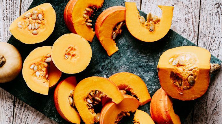 Pumpkin chopped up on a slate surface