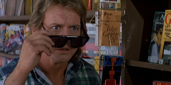 They Live Roddy Piper looking amazed with his special sunglasses