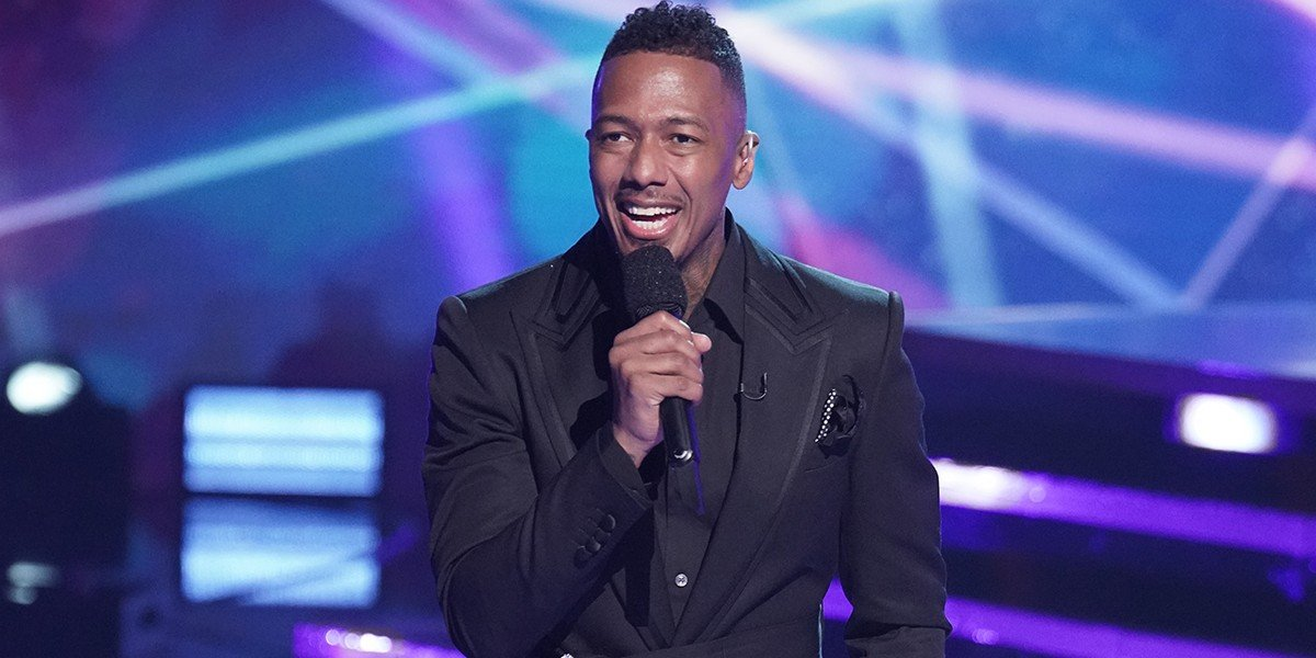 Nick Cannon smiling on The Masked Singer Fox