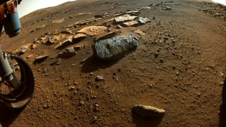 An image taken by the Perseverance rover on Mars shows a rock called Rochette with holes where the rover obtained its first two samples.