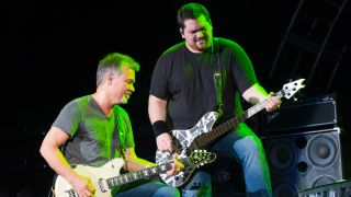 Guitarist Eddie Van Halen and Bassist Wolfgang Van Halen of Van Halen perform at Perfect Vodka Amphitheatre in West Palm Beach, FL