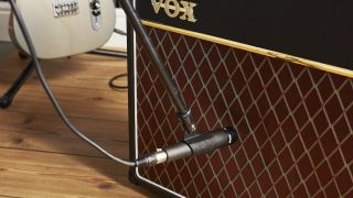 Shure SM57 microphone being used to record a Vox guitar amp