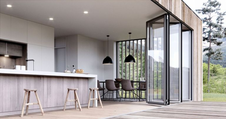 Exterior of a modern two-storey extension with sliding doors leading out to a terrace