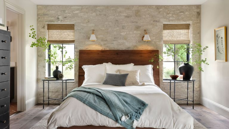 bedroom with exposed brick wall from Fixer Upper: Welcome Home