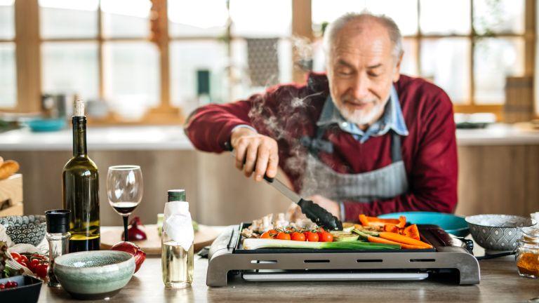 Senior man grilling vegan food