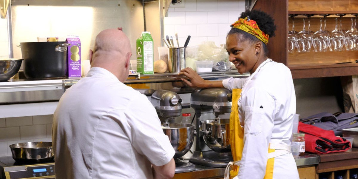 tom colicchio and dawn burrell in the kitchen on top chef season 18