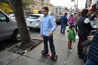A child rides a self-balancing scooter.