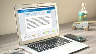 Laptop displaying text with spelling and grammar errors picked up by the WhiteSmoke program