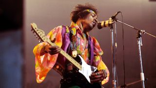 American rock guitarist and singer Jimi Hendrix (1942-1970) performs live on stage playing a black Fender Stratocaster guitar with The Jimi Hendrix Experience at the Royal Albert Hall in London on 24th February 1969