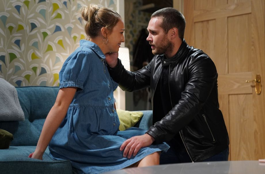 Keanu Taylor and Louise Mitchell wait for the ambulance in EastEnders