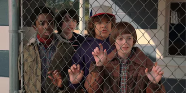 stranger things kids behind a fence