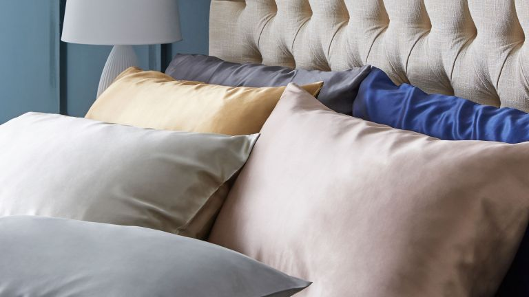 how to wash silk - a bed with silk pillowcases and headboard - dunelm_1307915