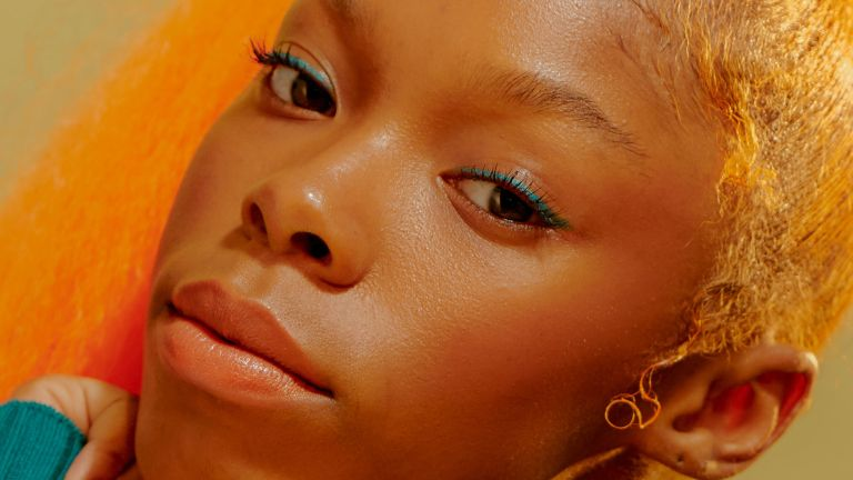 A young model poses with glowing skin