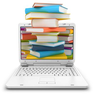 Stacks of books with colorful covers overflow from laptop computer screen.