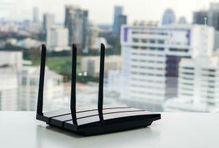 A Wi-Fi router on a windowsill.
