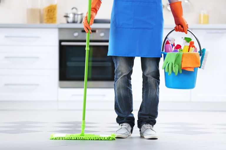 Person cleaning in a kitchen